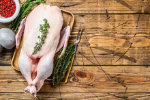 Raw Whole Farm Duck With Herbs. Wooden Background. Top View. Space For Text