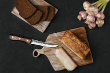 Overhead View Of Smoked Lard With Brown Bread On Wooden Cutting Board