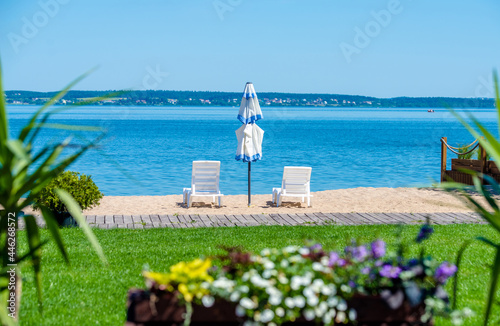 Fotografie, Obraz Sun loungers and umbrellas are on the beach