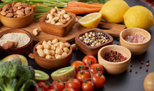 Different Vegetables, Seeds And Fruits On Table. Healthy Diet..vegetarian, Vegan Food Cooking Ingredients. Flat-lay Of Vegetables, Fruit, Beans, Cereals, Kitchen Utencil, Dried Flowers, Top View.