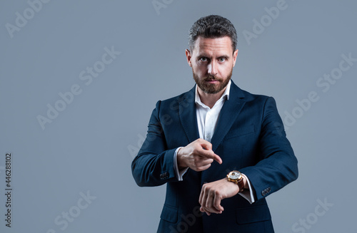 Valokuvatapetti businessman pointing finger on hand watch checking time, copy space, deadline