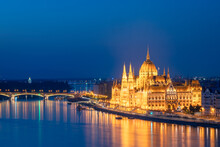 Side View Of The Hungarian Parliament Building Illuminated In Budapest, During Blue Hour