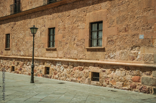 Tablou Canvas Deserted alley with old gothic building made of stone and public lamp at Salamanca