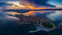 Aerial View To A Sea Town At Sunset