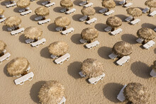 Aerial View Of Beach Umbrellas And Sunbeds On Sand Beach