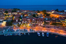Aerial View To A Sea Town At Night In Summer