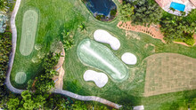 Aerial Drone Of Golf Course With Sand Trap And Lake