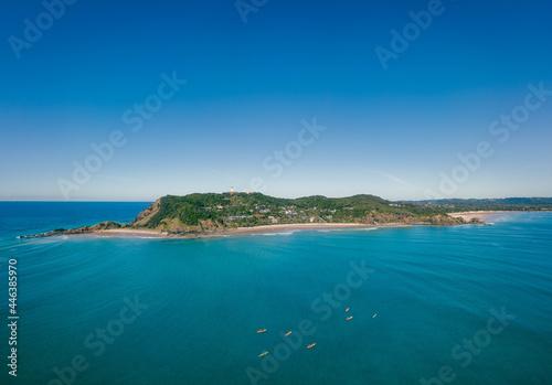 Tela An aerial panoramic view of Byron Bay and Wategos Beach