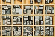 Collection Of Metal Letters In Wooden Box