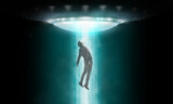 Man being abducted by UFO