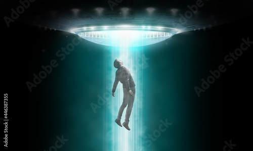 Fotografering Man being abducted by UFO