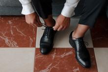 Stylish Man Tying Laces On Shoes