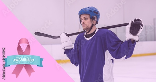 Composition of pink ribbon logo and breast cancer text, with hockey player