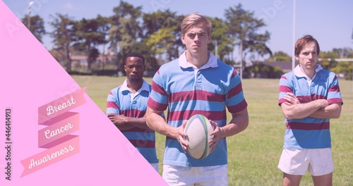 Composition of pink ribbon logo and breast cancer text, with rugby players