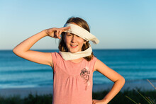 Tween Girl Being Silly, Making An Eye Patch With Toilet Paper, And Saluting