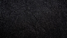 Abstract Blinking Background Black Fabric. Fabric Texture With Spangles