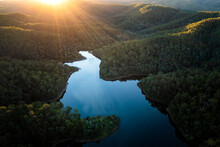 Aerial Landscape Of A Lake Surrounded By Forest