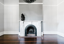 Traditional Open Fireplace With Marble Surround