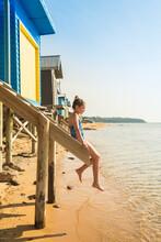 Tween Girl Sitting On Stairs At A Beach Box, Mt Martha