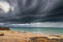 Dark Storm Clouds Over The Ocean And Darwin City