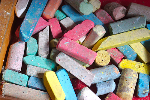 Fotografie, Obraz The fragments of old colored crayons in a forgotten drawer