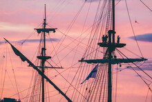 Sailors Take A Selfie On The Mast Of A Sailing Ship At Sunset