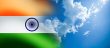 Indian Flag Waving On The Blue Cloudy Sky Background. India Independence Day.