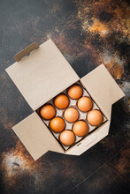 Chicken Eggs In An Egg Box Tray, On Old Dark Rustic Background, Top View Flat Lay
