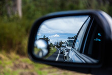 Backed Up Traffic In Car Side Mirror