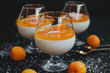 Classic Vanilla Panna Cotta In A Glass With Apricots And Coconut Flakes.