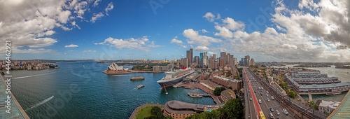 Fotografie, Obraz Aerial panoramic view of Sydney harbor from Harbor Bridge with skyline, opera ho