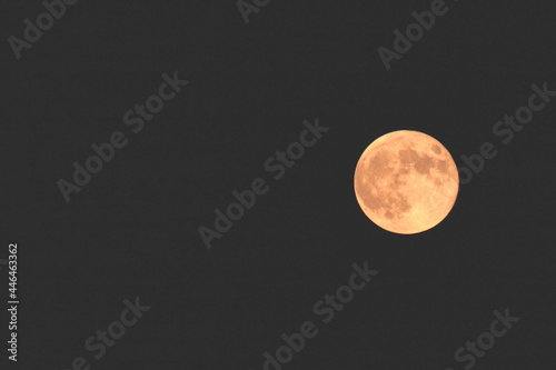 Fototapeta Beautiful moon on black background with place to write text in white letters abo