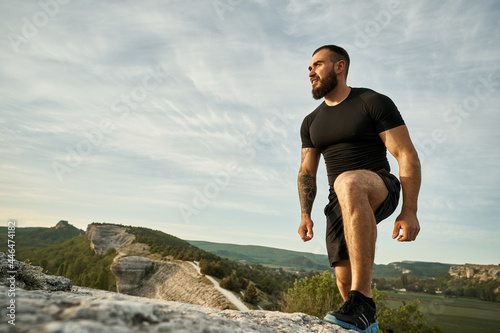 Fototapeta premium Close up of a man climbing the mountain