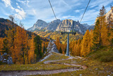 Ski lifts along the ski slope near the Cinque Torri mountains the background Tofane mountain near the famous town of Cortina d'Ampezzo in Italy