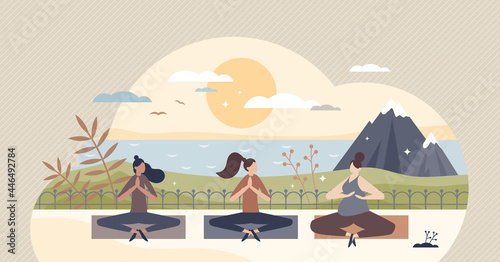 Fototapeta premium Yoga retreat and meditation group practice for body and mind wellness tiny person concept. Relaxation, breathing exercise, concentration and mindful balance together in sunset vector illustration.