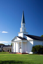 White Traditional Church With Tall Steeple