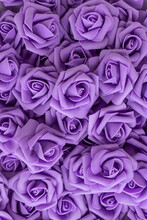 Background Of Purple Or Lilac Flowers. Fake Flowers. Artificial Purple Or Lilac Roses, Foamiran Roses.