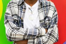 Crop Ethnic Man In Stylish Checkered Shirt In Street
