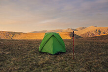 Tent Placed On Hill In Mountainous Terrain