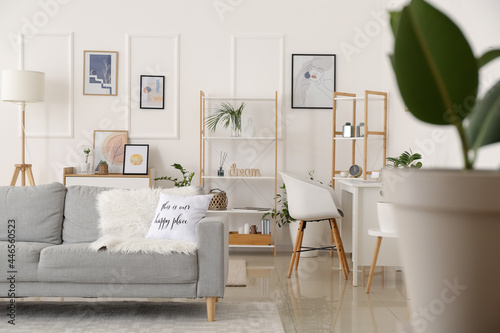 Fototapeta Interior of stylish living room with pictures
