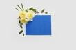 Leinwandbild Motiv Beautiful daffodils and blank card on white background