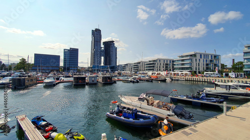 Fotografiet Gdynia, Poland - July 18, 2021: Motorboats and boats in a new modern marina in Gdynia, Poland