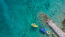Magnificent, Shallow Sea At The Shore Of Rogoznica, Small Fishing Town In Central Dalmatia, Croatia, With Stones And Rocks Underneath Clear Water Surface