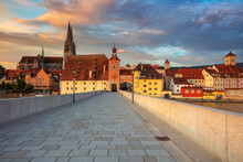 Regensburg, Germany. Cityscape Image Of Regensburg, Germany With Old Stone Bridge Over Danube River And St. Peter Cathedral At Summer Sunrise.
