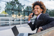 Content Black Businessman On A Phone Call On Smartphone In City
