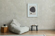 Leinwandbild Motiv Stylish composition of minimalistic living room interior with mock up poster frame, grey pouf, black tiny coffee table, wooden cube and elegant personal accessories on it. Template.