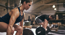 Sporty People Bend Their Knees Before Exercise