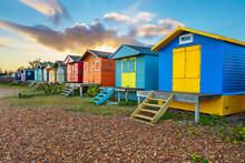 Colourful Beach Huts On Shingle Beach At Sunrise, Whitstable, Kent, England