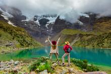 Two Woman Enjoying The View Of Crystal Clear Humantay Lake, Cusco, Peru