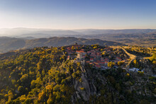 Drone Aerial Panorama Of Historic Village Of Sortelha With Castle And With Turbines On Natural Landscape, Centro, Portugal